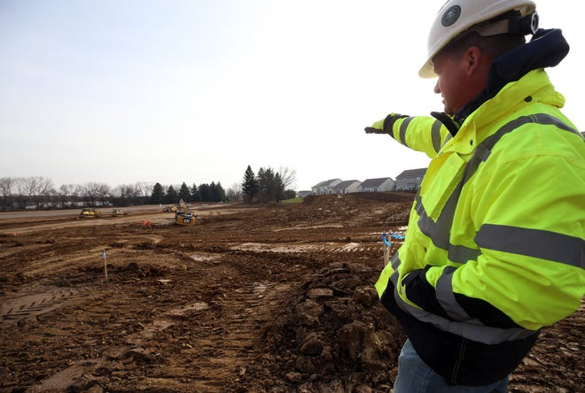Ryan Felumlee, superintendent with Heath-based Robertson Construction Services Inc., describes the progress being made on the new Westerville elementary school Dec. 15.