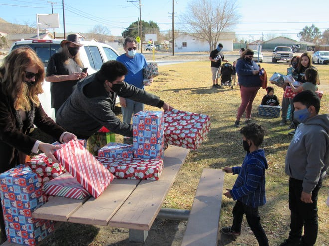 """Volunteers pass out Christmas presents to the children of Oro Grande during Joe Manners' annual """"Kids Christmas Party on Dec. 19, 2020."""