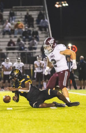 Ennis linebacker Payton Chapman (2) shows his strength against Crandall earlier in the season. Chapman overcame a broken leg in last year's playoffs to break the single-game school record for tackles this season.