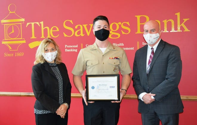 Navy Reservist, Second Class Petty Officer Matt Barton, center, a floating branch manager at The Savings Bank, presented a Patriot Award from Employer Support of the Guard and Reserve to Bruce Donovan, right, senior VP, branch administrator at The Savings Bank. Barton nominated Donovan for the support provided to the Barton family during Barton's 11-month deployment. Also shown is Raichelle Kallery, executive VP, senior retail banking officer at The Savings Bank.