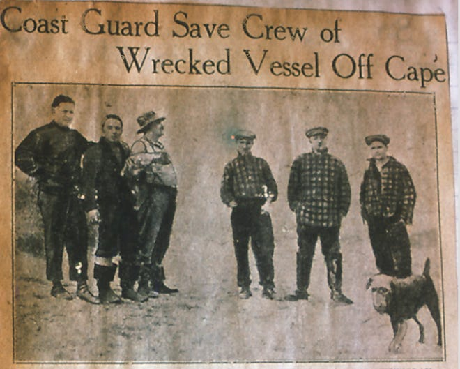 """A newspaper headline and photograph show the crew of the A. Roger Hickey, along with the ship's mascot, """"Buddie,"""" following their rescue by the Coast Guard."""