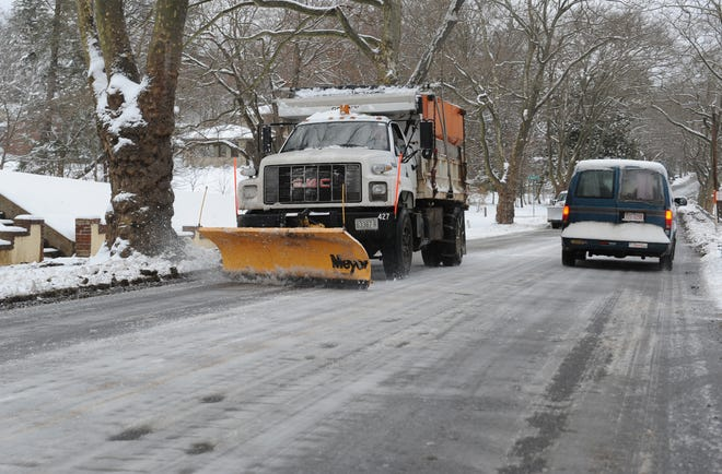 A snow plow clears Merrimon Avenue in January 2010.