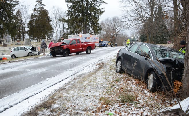 Five people were hurt Monday in a three-vehicle crash on icy Capital Avenue Southwest in Leroy  Township.  (Trace Christenson/The Enquirer)