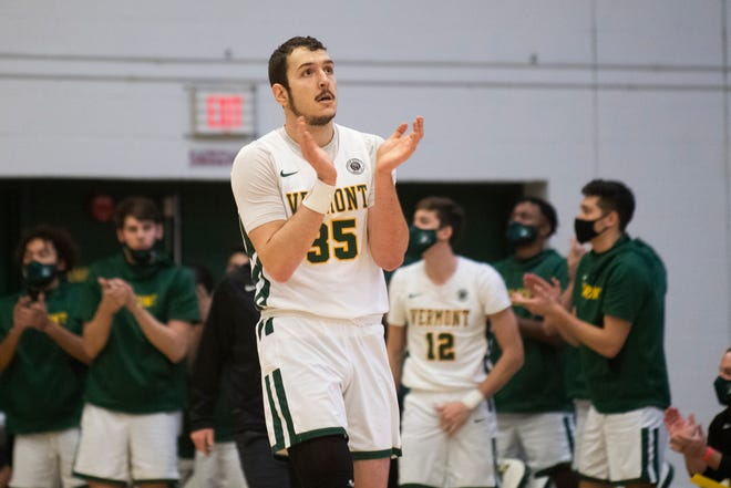 Vermont's Ryan Davis (35) celebrates after a basket during the men's basketball game between the NJIT vs. Vermont at Patrick Gym on Sunday afternoon December 27, 2020 in Burlington, Vermont.