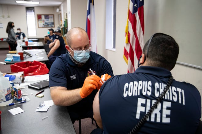 The Corpus Christi Fire Department gives COVID-19 vaccinations to Nueces County first responders at the Corpus Christi Fire Department headquarters on Monday, Dec. 28, 2020.
