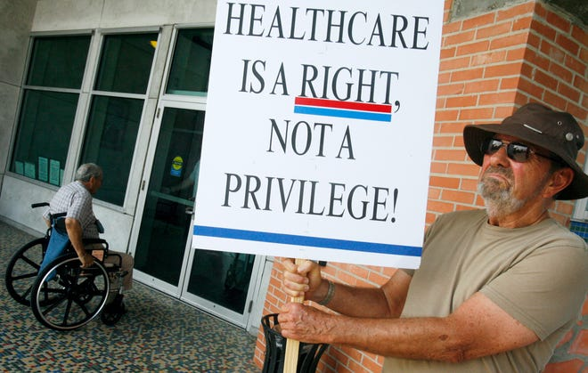 A protestor outside the Congressman Solomon P. Ortiz International Center in 2009 for a town hall meeting.