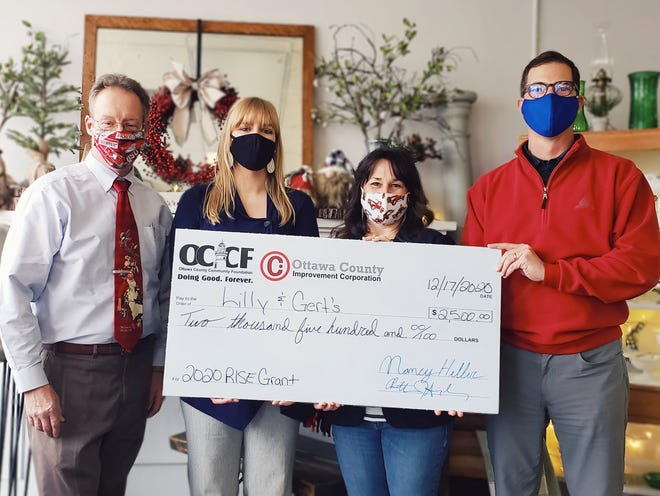 A RISE Grant check is resented to  Lilly and & Gert's. Left to rigth are John Madison, Ottawa County Community Foundation; Jessica Grzechowiak, OCIC; Dina Rodgers, owner of Lilly and Gert's; and Chris Singerling, OCIC.