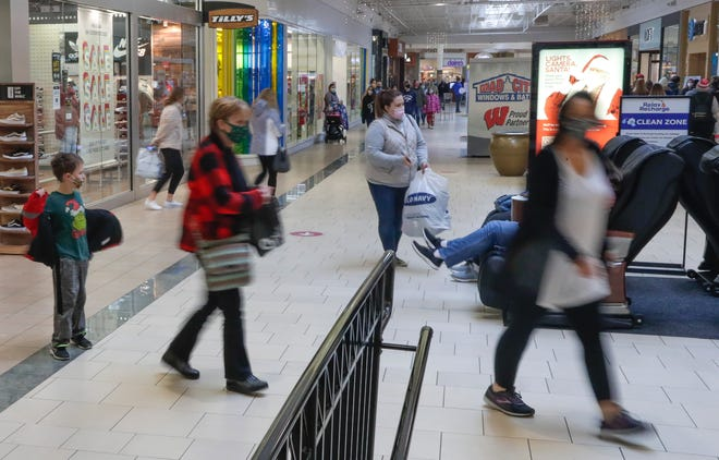 Shoppers purchase and return items the day after Christmas at Bay Park Square Mall in Ashwaubenon. Brown County collects a half-percent sales tax on purchases, and argues the money goes toward property tax relief because it pays for projects that homeowners would otherwise fund.