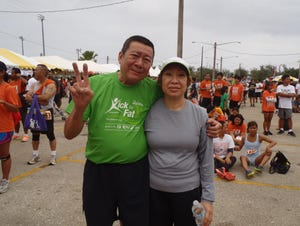 For more than a decade, Duc Chung Dao (left) passed out water to Guam Running Club runners.