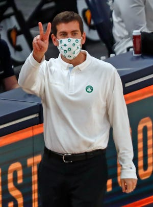 Celtics coach Brad Stevens gestures to his players on the court during a Dec. 27 game at the Indiana Pacers. With the NBA's latest announcement on Monday, the Celtics' last two scheduled games have now been postponed due to COVID-19 concerns.