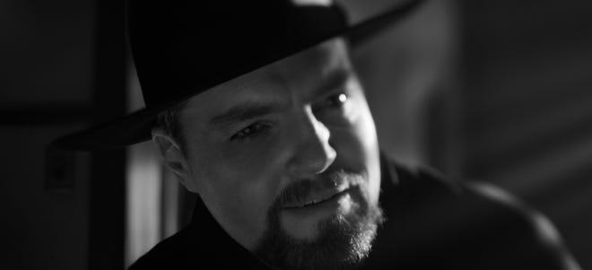 "Tom Burke plays Orson Welles in David Fincher's ""Mank."""