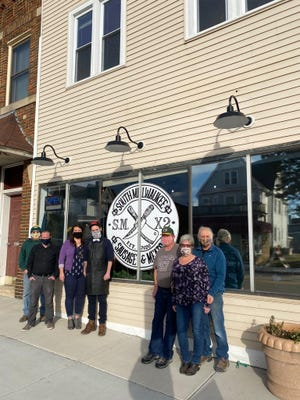The team behind South Milwaukee Sausage & Meats gathers outside the business.