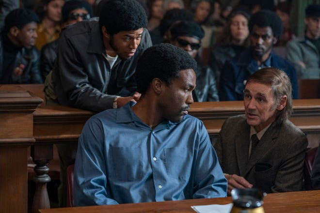 """Attorney William Kuntsler (Mark Rylance, right) counsels Chicago 8 defendant Bobby Seale (Yahya Abdul-Mateen II) as Black Panther leader Fred Hampton (Kelvin Harrison Jr.) looks on in """"The Trial of the Chicago Seven."""""""