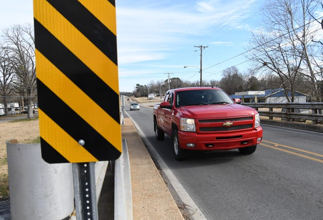 Traffic passes over the Hicks Creek bridge along Arkansas Highway 5 on Monday. The Arkansas Department of Transportation plans to replace the bridge and turn over an almost 2-mile section of the highway to the City of Mountain Home to maintain as a city street.