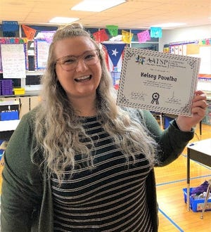 Kelsey Pavelka, a second-grade teacher at West View Elementary School, shows her Outstanding Dual Language Teacher award from the merican Association of Teachers of Spanish and Portuguese.