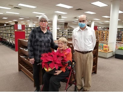 Virginia Slotnick, center, is the Livonia Public Library's oldest patron.