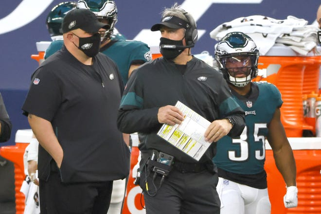 Philadelphia Eagles head coach Doug Pederson works from the sidelines against the Dallas Cowboys during an NFL football game in Arlington, Texas, Sunday, Dec. 27, 2020. (AP Photo/Ron Jenkins)