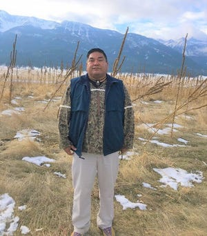Nez Perce Tribal Executive Committee Chairman Shannon Wheeler stands on the tribe's newly purchased property near the Wallowa Mountains in Joseph.