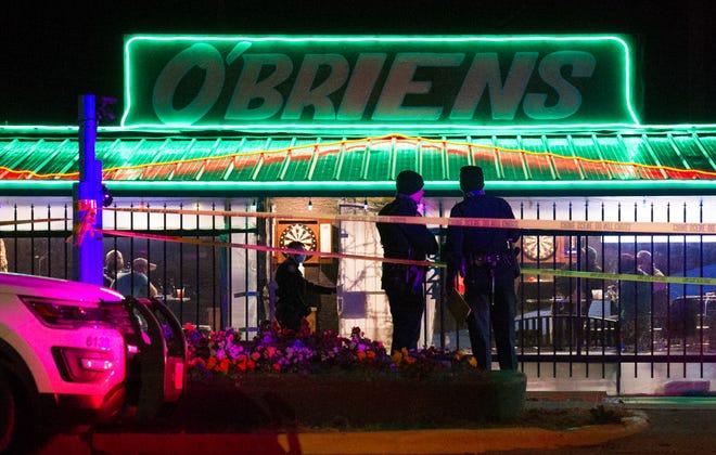 Wichita Falls Police work the scene of a murder at O'Brien's Sports Pub Dec. 28.