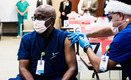 Henry Jackson, an employee of Lee Health in the transportation services department is one of the first front-line workers for Lee Health to get the COVID-19 vaccine. The vaccine was administered at Lee Health Gulf Coast Medical Center in Fort Myers, Fla. on Dec. 22, 2020.