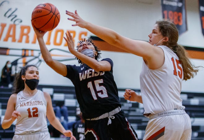Weiss guard Omareya Wash shoots past Westwood's Emma Zion during their nondistrict game last month.