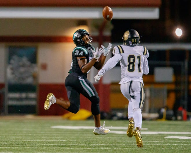Cedar Park senior  Josh Cameron, catching a pass during a playoff victory over Richmond Foster, is part of a wide receiver trio that has combined for 36 touchdown receptions. The Timberwolves are unbeaten heading into a fourth round playoff game against Manvel.
