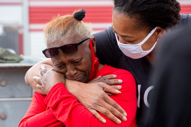 Resident Janet Peel is overcome with emotion as she is embraced by her friend Kisha Sanders outside of the building where she lives, which  caught fire on Wentworth Drive in Northeast Austin on Tuesday.