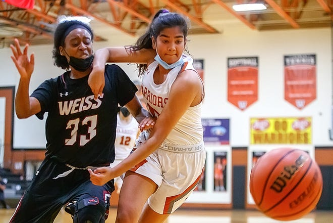 Westwood guard Anisha Chintala, right, battles against Weiss guard Jodie Robinson for the loose ball during the second period at the nondistrict girls basketball game on Monday at Westwood High School. Westwood had a late run to secure a 55-52 win.