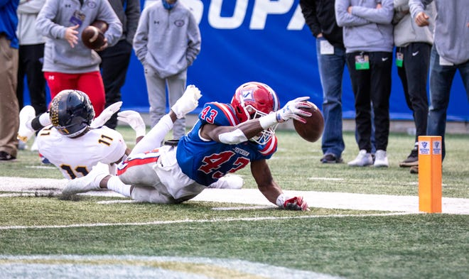 Jordan Perry dives in for a touchdown in the second quarter on Tuesday during the Class 4A state championship game.
