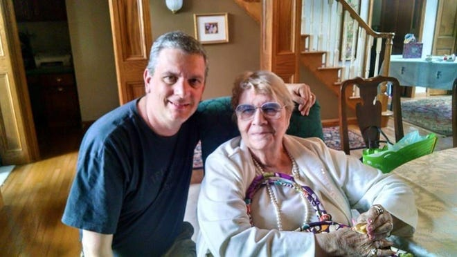 Akron Beacon Journal reporter Craig Webb pictured with his mother, Janet, who recently died of complications of COVID-19.