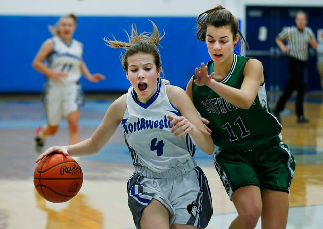 Northwestern's Caydance Scale (4) drives the ball as Smithville's Kirstyn Thut (11) defends. The Smithies won, 45-39.
