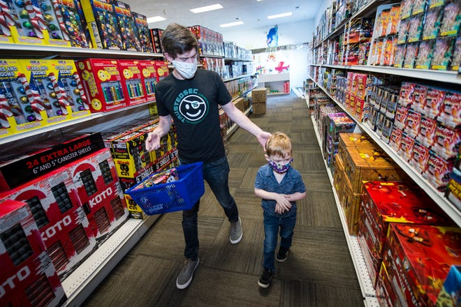 Wes Lambert and his son Harrison, 4, shop for fireworks at Wacky Wayne's Fireworks in North Augusta on Tuesday.
