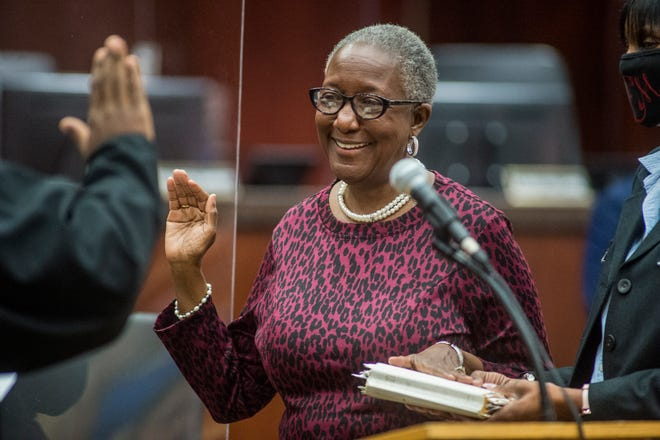 New Super District 9 Commissioner Francine Scott is sworn in by Juvenile Court Chief Judge Keith Johnson on Tuesday.