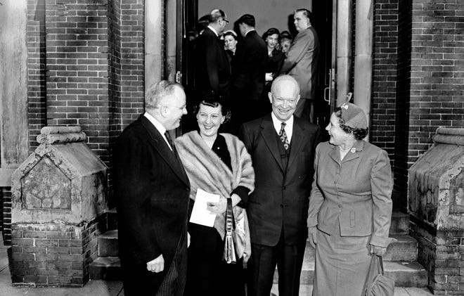 President and Mrs. Eisenhower, center, are flanked by the Rev. Frank Q. Echols, pastor of St. James Methodist Church, and Mrs. Echols after emerging from 11:15 am services Jan. 3, 1954. The chief executive and his wife visited the downtown church on an invitation from the Rev. Echols, president of Augusta Ministerial Association on behalf of Augusta ministers. Mrs. Eisenhower wears her pastel mink stole.