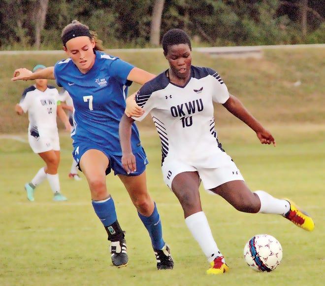 Marjolen Nekesa, right, has been a high-powered attacker for Oklahoma Wesleyan University women's soccer team.