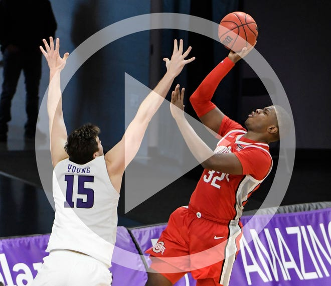 Ohio State forward E.J. Liddell (32) shoots over Northwestern center Ryan Young (15) during the second half of an NCAA college basketball game, Saturday, Dec. 26, 2020, in Evanston, Ill.