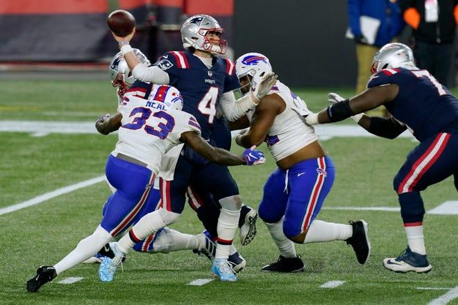 New England Patriots quarterback Jarrett Stidham passes under pressure from the Buffalo Bills during Monday's game in Foxboro.