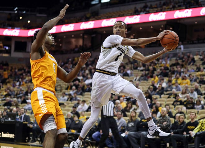 Missouri guard Xavier Pinson (1) passes the ball while jumping out of bounds against Tennessee guard Josiah-Jordan James (5) during a game last season at Mizzou Arena.