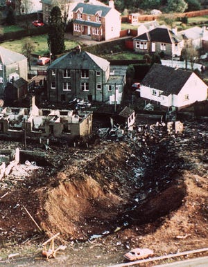 This Dec. 1988 file photo shows wrecked houses and a deep gash in the ground in the village of Lockerbie, Scotland caused by the crash of Pan Am Flight 103 on Dec. 21, 1988. The explosion would quickly transform the Scottish town into a byword for international terror.