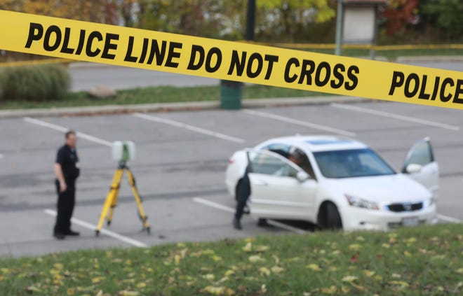 Columbus Police crime scene officers at a Griggs Reservoir homicide scene on Thursday, Oct. 22, 2020. The death was the city's 132nd homicide of 2020 amid rising gun violence in Columbus and Franklin County.