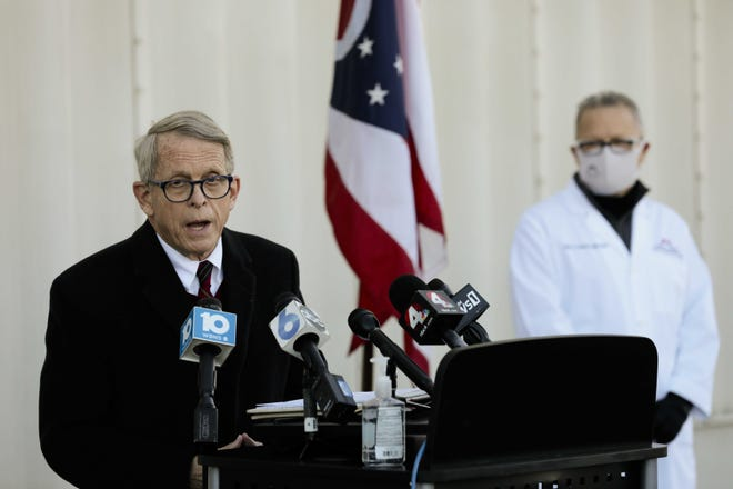 Gov. Mike DeWine, pictured earlier this year during a briefing about the COVID-19 pandemic, delivered his final scheduled briefing of 2020 on Wednesday.