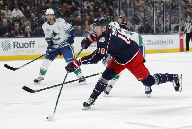 Blue Jackets center Pierre-Luc Dubois fires a shot during a game against the Vancouver Canucks on March 1.