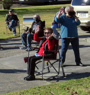 Mabel Panvelle waves to well-wishers Sunday as they drive by her Thibodaux home to wish herhappybirthday. Friends, family and neighbors organized the drive-by celebration for Panvelle, who turned 100 Tuesday, Dec. 29. Driving by in their cars ensured everyone follows social-distancing guidelines amid the COVID-19 pandemic.