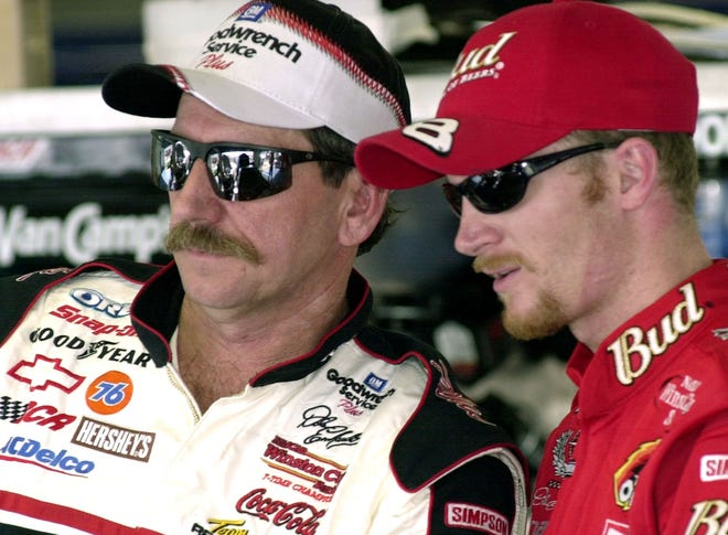 Dale Earnhardt, left, and his son Dale Jr., stand together during a practice at Daytona International Speedway on Feb. 8, 2001. Earnhardt Sr. would die nine days later from injuries suffered in a last-lap crash in the 2001 Daytona 500.