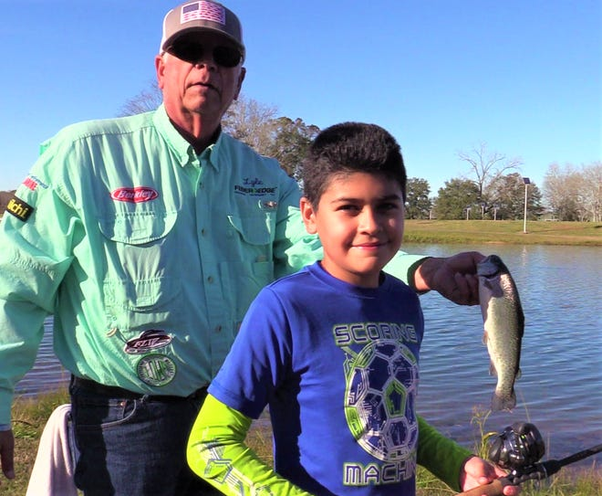 Eduardo & Jamar—These two young boys, Eduardo & Jamar not only caught their first two fish in the big pond but it was also their first rainbow trout ever.