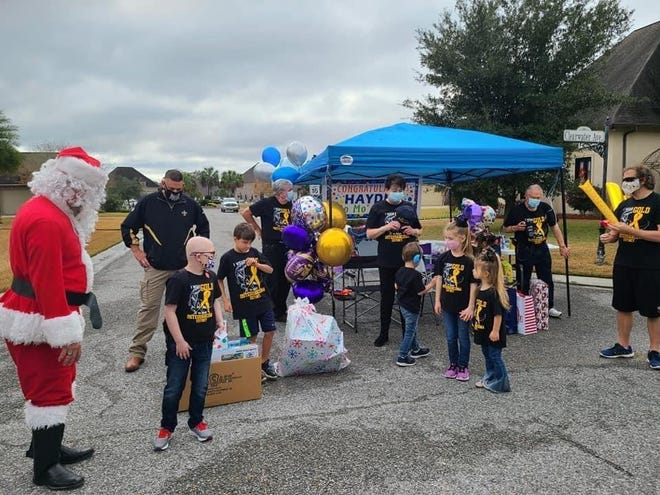 More than 200 vehicles participated in a parade celebrating 8-year-old Hayden White, who had undergone cancer treatments.