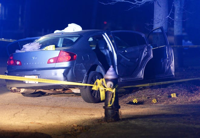 In this Saturday, April 7, 2018, file photo, a car is seen crashed into a tree on Woodland Avenue in Brockton after Kelby Ramos, 24, was shot in the head. He was taken to a local hospital, where he died.