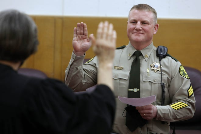 Kevin Glendening is sworn in Dec. 29 as the new Des Moines County sheriff by District Judge Mary Ann Brown during a swearing-in ceremony of elected officials in the third-floor courtroom at the Des Moines County Courthouse.
