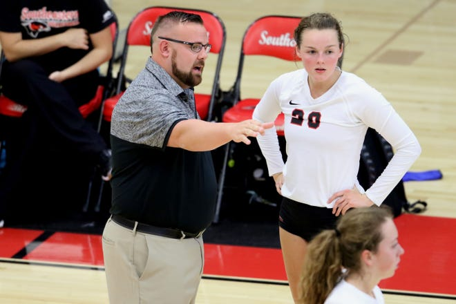 Southeastern Community College Blackhawks head coach James Rogers talks with Paige Kammerer (20)  during one of their games of their match against the NIACC Trojans, Wednesday Sept. 13, 2017 at SCC's Loren Walker Arena.