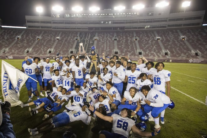 Trinity Christian celebrates after defeating Chaminade-Madonna 25-22 in the FHSAA Class 3A state football championship. The Conquerors have multiple selections to the All-First Coast team.